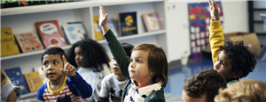 Kindergarten students raising hands