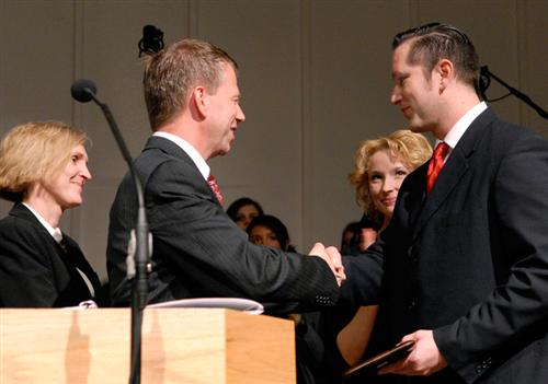 Mr. Marks recieving an award from his college as the 2006 Alumni of the Year.