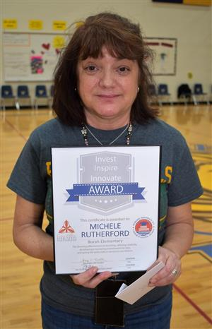4th grade teacher Michele Rutherford accepted Teacher of the Month honors for May