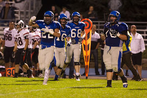 Coeur d'Alene High linebacker Drew Berger celebrates a big play during the Vikings' recent game against Highland High.