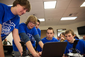 Tera Viks team members gather around a laptop to fix connection problems with last year's robot on Wednesday at the Universit